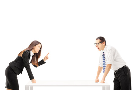 threats: Angry businessman yelling at businesswoman who is threatening isolated on white background Stock Photo