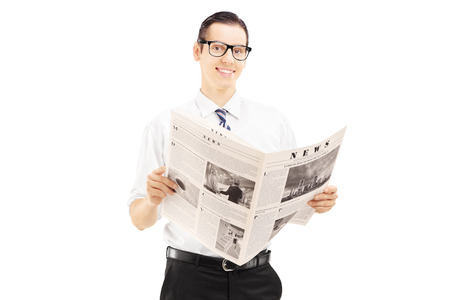 Young businessperson standing and reading a newspaper isolated against white  photo