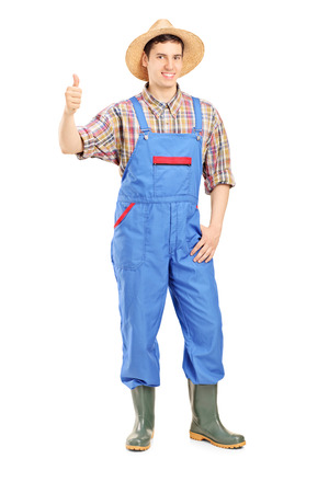 farmer sign: Full length portrait of a young smiling farmer giving a thumb up isolated on white background Stock Photo