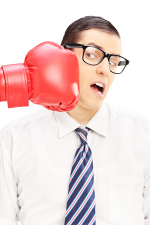 punched: Young man punched by a red boxing glove isolated on white background