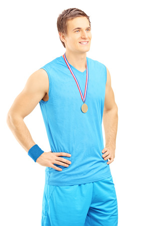 Satisfied basketball player posing with a golden medal and looking isolated on white background photo