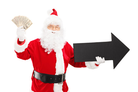directive: Smiling Santa Claus holding big black arrow pointing right and US dollars isolated on white background Stock Photo