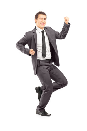 Full length portrait of a happy young businessman gesturing happiness isolated on white background photo