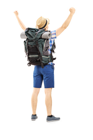 Full length portrait of a male hiker with raised hands gesturing happiness isolated on white background 版權商用圖片 - 23547192