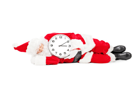 late 50s: Santa Claus sleeping with a clock and running late, isolated on white background   Stock Photo
