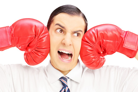 punched: Young man punched by red boxing gloves isolated on white background