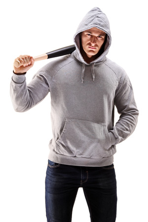 Male with hood over his head holding a baseball bat symbolizing crime isolated on white background photo