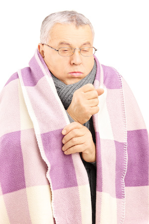 Senior man covered with blanket and neckwear coughing because of pulmonary disease isolated on white background photo