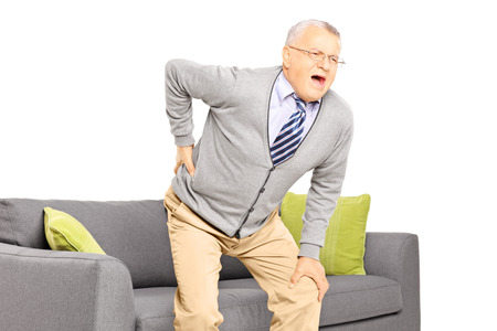Senior man suffering from back pain isolated on white background photo