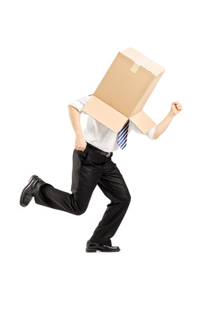 Full length portrait of a guy with a cardboard box on his head running away isolated on white background photo