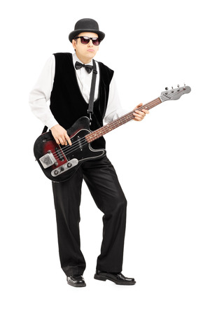 bass player: Full length portrait of a person playing a bass guitar isolated on white background