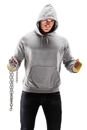 Guy with hood over his head holding a chains, symbolizing crime isolated on white background photo