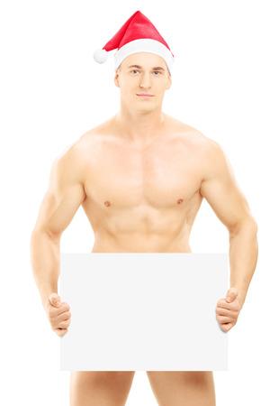 homme nu: Mec nu avec un chapeau de No�l tenant un panneau blanc, isol� sur fond blanc