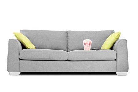 Studio shot of a modern couch with popcorn box on it isolated on white background Stock Photo - 24401362