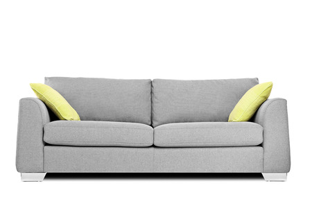Studio shot of a modern couch with pillows isolated on white