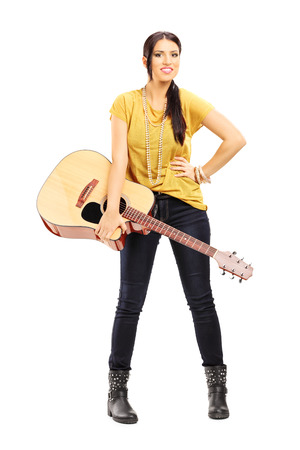 woman guitar: Full length portrait of a female musician holding an acoustic guitar isolated on white background