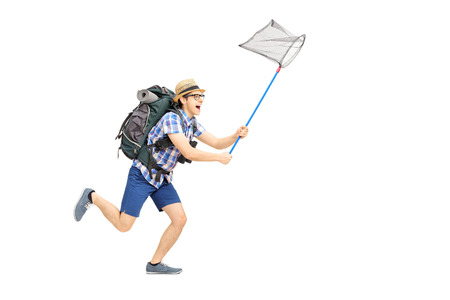 Full length portrait of a male tourist running with butterfly net isolated on white background photo