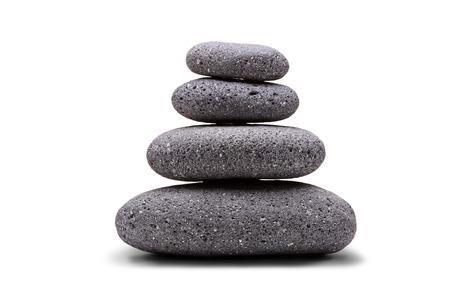 white pebble: Stack of balanced stones isolated on white background