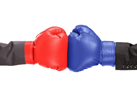 brawl: Two boxing gloves isolated on white background Stock Photo