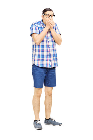 afraid man: Full length portrait of a frightened young man looking isolated on white background Stock Photo