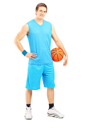 Full length portrait of a male basketball player holding a ball isolated on white background photo