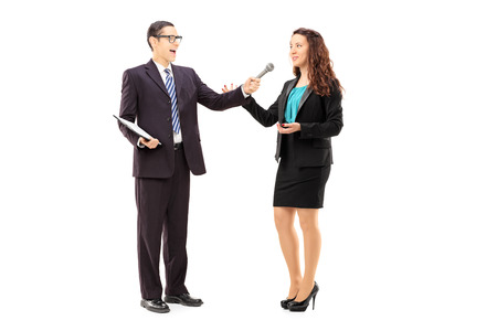 Full length portrait of young man conducting survey on woman, isolated on white background photo