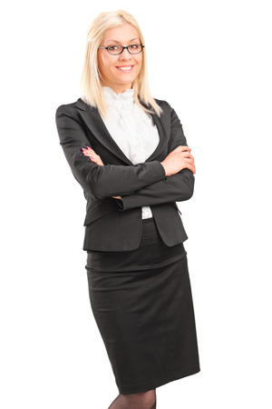 cross armed: Smiling young businesswoman standing, isolated on white background