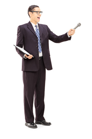 medium length: Full length portrait of a survey conductor holding clipboard and microphone, isolated on white background Stock Photo