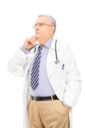 deep thought: Middle aged male doctor deep in thoughts, isolated on white background