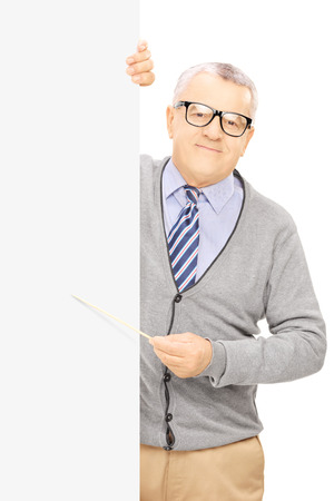 Senior man standing next to blank panel and holding a stick, isolated on white background photo