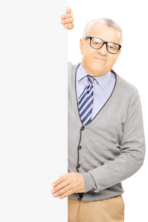 Senior man standing next to blank panel and posing, isolated on white background photo
