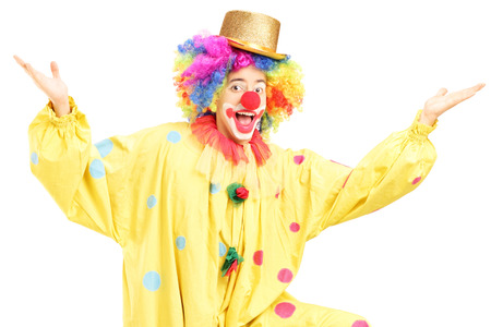 Male funny circus clown posing isolated on white background photo
