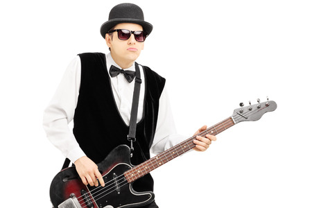 bass player: Person playing a bass guitar isolated on white background Stock Photo