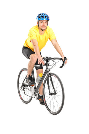 Young male biker looking at camera, isolated on white background photo
