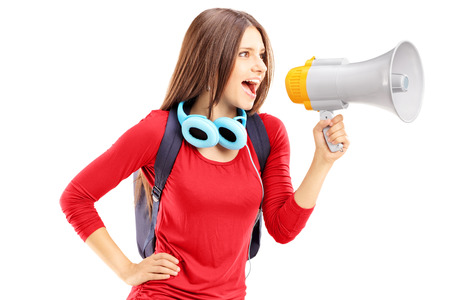 Female student shouting via megaphone isolated on white background Stock Photo - 24935063