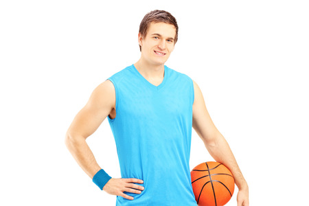 Male basketball player holding a ball isolated on white background photo