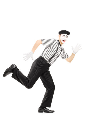 runaway: Full length portrait of a scared male mime artist running away isolated on white background Stock Photo