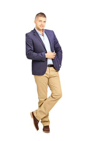blazer: Full length portrait of young fashionable man leaning against a wall isolated on white background