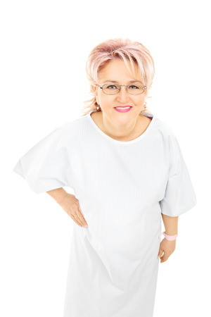 hospital gown: Mature female patient in gown looking at camera, isolated on white background