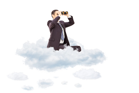 flying man: Young businessman looking through binoculars seated on cloud isolated on white background Stock Photo