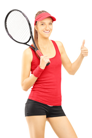 Young female tennis player giving thumb up isolated on white background photo