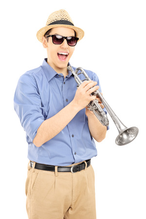 trumpeter: Excited young musician wearing sunglasses and holding a silver trumpet, isolated on white background