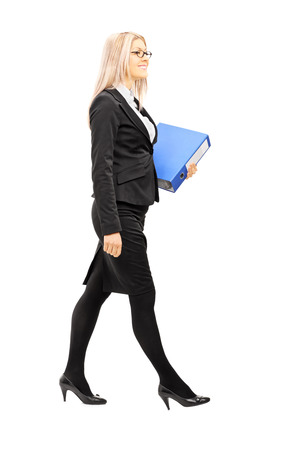 Full length portrait of businesswoman holding a folder isolated on white background photo