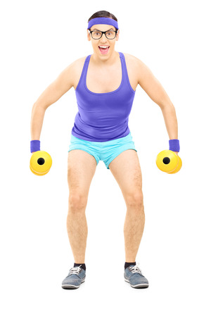 Nerdy guy exercising with dumbbells isolated on white background photo