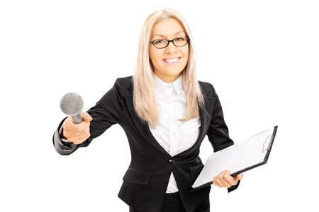 conducting: Young female interviewer holding clipboard and microphone, isolated on white background