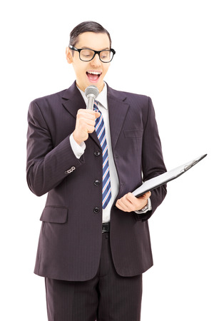 announcer: Young male presenter holding microphone and clipboard, isolated on white background