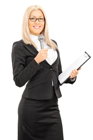 announcer: Young female presenter holding microphone and clipboard isolated on white background