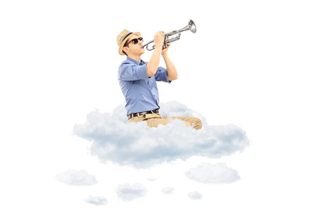 trumpeter: Young male musician playing a trumpet on clouds isolated on white  Stock Photo