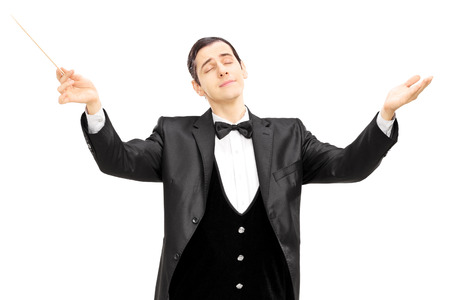 Male orchestra conductor directing with baton isolated on white background photo