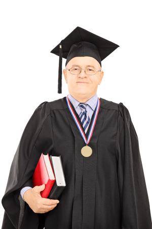 dean: Portrait of a university dean in graduation gown posing isolated on white background Stock Photo